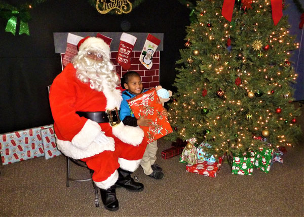 Santa Meets Excited Kids at Bucky James Center